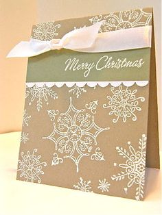 Stamps: serene snowflakes, four the holidays Paper: kraft, whisper white, mellow moss Ink: versa mark, white embossing powder Accessories: scallop edge punch, white satin ribbon