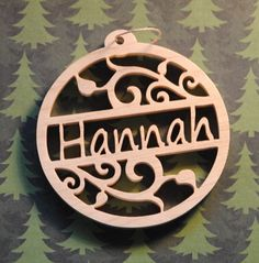 Personalized Name Wooden Christmas Tree Ornament Here is a really nice 1/4 thick hand scrolled name ornament cut from solid wood that will really please everyone both young and old this Holiday season. Their very own name Christmas tree ornament. Just a wonderful addition to your Tree