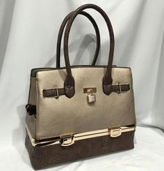 """This is one stylish looking purse with the additional benefit of being a discrete beverage dispenser as well! Take this fashion statement along with your favorite wine to the next Girls Night Out, Concert, Movie, Picnic or Party OR give it as a gift… you will be the star of the evening!  This beautiful, rose gold satchel is approximately 13"""" L x 11"""" H x 6.5"""" D and 17"""" H with handles up. It has a zipper closure on top as well as a zipper pocket on the back side. Inside there are two open…"""