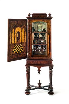 Miniature miniatures by über-talented Nell Corkin! The rooms in this baby house are in 1:144 scale. Gilbert Mena created The 1:12-scale cabinetry and marquetry work. The piece is fashioned after 1700's Dutch cabinets that were converted to doll houses.