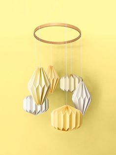 """A stunning hand crafted hanging mobile consisting of six individual geometric shapes folded from specialty stocks. A beautiful wooden """"halo"""" hovers above—complementing the materials below. A unique display worthy of any nursery or child's room. Child's Room, Nursery Room, Nursery Decor, Baby Nest, Hanging Mobile, Yellow Cream, Kidsroom, Geometric Shapes, Baby Shop"""