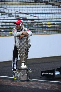 Tony Kanaan hugs the Borg Warner trophy. Indy 500 winner 2013