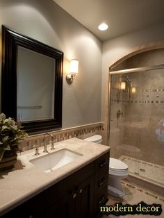 LIKE DARK CABINET AND MIRROR AND EVERYTHING ELSE LIGHT .Like curve around shower