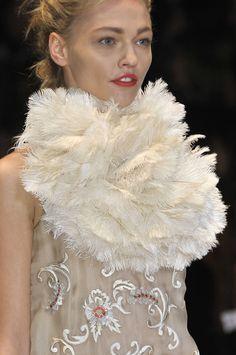 White feathered neck adornment