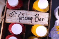 """Gourmet burger bar with some of the simpler niceties of the condiment world....and a fun hand painted sign, """"DJ's Ketchup Bar""""....DJ the ring bearer And son of the groom loves ketchup!"""