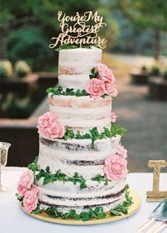 Romantic chic light frosted wedding cake topped with precious pink flowers; Featured Photographer: Jamie Rae Photography