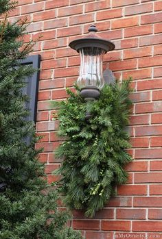 How to Make and Decorate with Holiday Greenery To Hang Over an Outdoor Light | In My Own Style #outdoorholidaydecorations