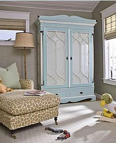 love the patterned chair and blue and white armoire in a kids room