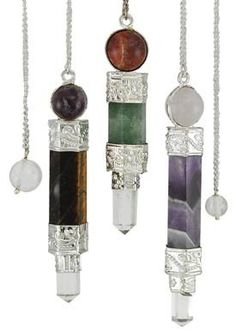 Called a three piece pendulum for the three pieces of semi-precious stone that they are composed of, each of these pendulums features a bob ending in a quartz crystal point, with a faceted gem stone body, and a smoothed gemstone ball at its top, all fastened together with silver-toned metal. The result is a wonderful array of gemstone pendulums, beautifully sculpted to help you interpret the pendulum`s sway within your dowsing and divination. Exact sizes and compositions may vary, but  $9.95
