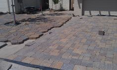 Belgard Mega Arbel and Bergerac pavers side-by-side in the same driveway add two textures and interests in Phoenix, Arizona     IMAG1696.jpg picture by PaverMaster - Photobucket