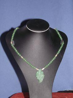 Adventurine and aragonite with crystal bicones and large adventurine leaf
