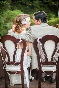 Bride and groom wedding chair decor with pearl strands