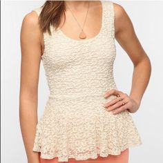 UO Lace Peplum White Top Worn twice, in great condition. Off-white floral lace overlay. Tank top. Peplum cut at the waist. Price is negotiable  Urban Outfitters Tops Tank Tops