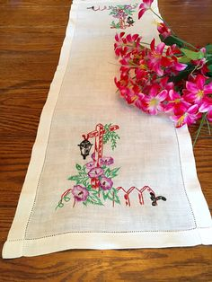 A vintage linen table runner or dresser scarf with pretty hand embroidered purple flowers on a lamp post and finished with a hem stitched border. It measures 12 x 35 and is in good condition. Shipping on multiple purchases will be combined. Hand Embroidery, Machine Embroidery, Hem Stitch, Pretty Hands, Old Dressers, Vintage Linen, Runes, Purple Flowers, Table Runners
