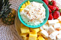Pina Colada Dip  1-8 oz pkg  cream cheese softened ,1-7 oz  jar  marshmallow creme,                 1 can ( 8 ounce ) crushed pineapple drained,                 1/2 c flaked coconut,                 1 pound cake or angel food cubed,                 strawberries,                 fresh pineapple,cubed,                    Beat cream cheese & marshmallow creme until fluffy.                Fold in pineapple & coconut. Cover & chill .