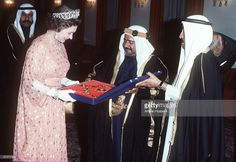 Queen Elizabeth II receives a gift from the Amir of Bahrain during her tour of the Middle East in February 1979.