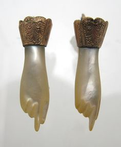 Victorian mother of pearl hand earrings. Victorians are weird and like wearing body parts as jewellery.