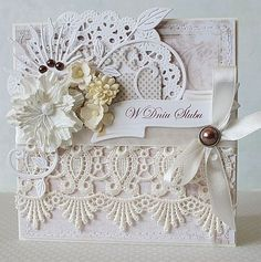 wedding card.. What a wonderful way to use old lace and paper.