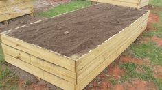 After about 20 loads, it's filled and ready for planting! Building Raised Garden Beds, Little Designs, Planting, Wood, Diy, Home Decor, Plants, Decoration Home, Woodwind Instrument