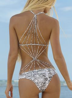 Funky one-piece features criss-cross detailed string crochet back, and looks like an ordinary bikini in the front by MIKOH Swimwear, $202.00