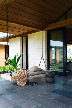 Nicole Hollis designed this contemporary home in Hawaii for a couple who were Southern California natives that fell for the coast of Kona long ago. The home boasts indoor/outdoor living that's complete with a relaxing bench swing to enjoy the Hawaiian breeze. Photo courtesy of Laure Joliet