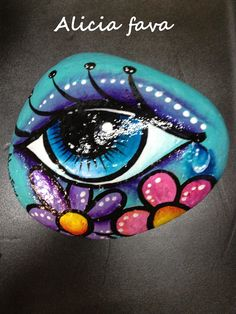 Hand Painted eye rock with flowers