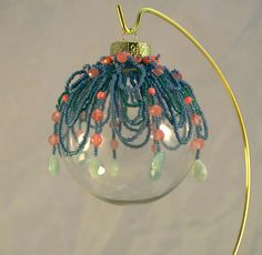 Netted Ornament: Teal and Salmon. $50.00, via Etsy. Victorians used beaded nettings to decorate their ornaments. Each takes about 5 hours to create, and is separate from the ball, so it can be switched out!