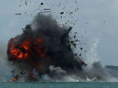 One of seven fishing boats is blown up by the Indonesian government in Batam, Kepulauan Riau province as they sank 27 impounded foreign boats as the world's largest archipelago nation stepped up a campaign against illegal fishing in its waters.  Sei Ratifa, AFP/Getty Images
