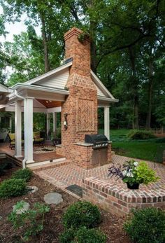 A backyard retreat with covered porch and open patio. Wood burning fireplace and grill area. Ipé decking for porch floor. A backyard retreat with covered porch and open patio. Backyard Privacy, Backyard Retreat, Backyard Patio, Backyard Landscaping, Landscaping Ideas, Pavillion Backyard, Pergola Patio, Small Brick Patio, Brick Patios