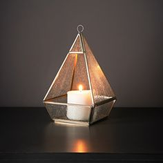 A stylish Pyramid Candle Holder, perfect for adding character to your home. Fabulous glass casing enhances your candle's shimmering light - B&M Stores.