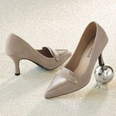 Triangle Pump by Classique from Monroe and Main. Earn all the style points you'll need in this slender design with the stylish look and feel of leather and suede.