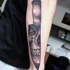 Man With Skull Chef Knife Tattoo On Outer Forearm