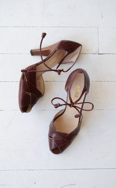 Sexy vintage 1970s burgundy leather heels with peeptoe, tie ankle and tall stacked wood heel.  ✂-----Measurements  fits like: us 6.5 | euro 37 | uk 4 insole: 9.5 ball: 3 heel: 3.5 brand/maker: Palizzio condition: excellent  ➸ more vintage footwear http://www.etsy.com/shop/DearGolden?section_id=5800174  ➸ visit the shop http://www.DearGolden.etsy.com _____________________  ➸ blog | www.deargolden.com ➸ twitter | deargolden ➸ facebook.com | deargolden