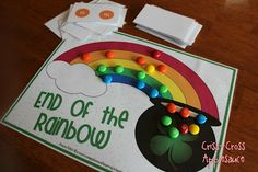 M&M Rainbow Game for practicing color sorting, counting and taking turns with printable