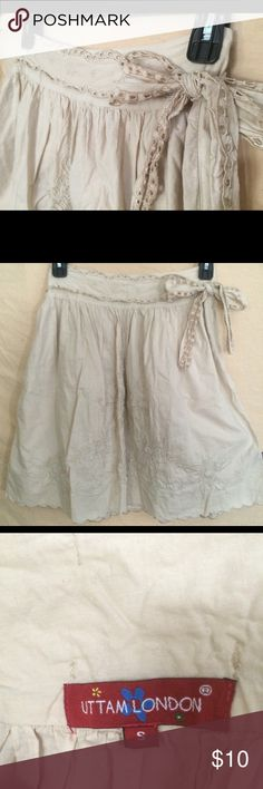 Beige skirt Beige skirt with flower stitching, worn a few times. Very cute on. Size S. Skirts Midi