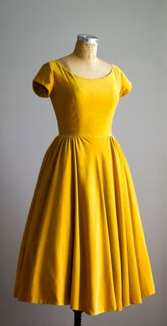 vintage 1950s goldenrod yellow velvet dress with a fitted bodice, scoop neckline, short cap sleeves, side metal zipper, very full skirt and tight