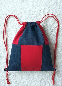 Clever and comfortable bag - jeans backpack in gray graphite with red inserts. The backpack has been designed so that it can be worn freely choosing the front and back. Closes by pulling both strings sideways. Cotton cords in red, pulled through the loops Jean Backpack, Backpack Bags, Denim Tote Bags, Backpack Pattern, Diy Handbag, String Bag, Knitted Bags, Small Bags, Bag Making