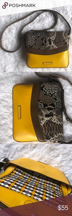 Vera Bradley Twice as Nice Crossbody Twice as Nice Crossbody IN MAIZE WITH PYTHON PRINT Convenience increases twofold on account of this feisty bag's dual secure compartments. A textured snake print adds a touch of wild style.  8.5'' W x 7.5'' H x 1.75'' D 56'' strap length Man-made Lined Magnetic flap closure Two compartments Interior: one zip and one slip pocket Exterior: one slip pocket Adjustable strap Imported Vera Bradley Bags Crossbody Bags