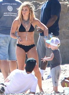 Making her comeback! She displayed her fabulous figure while shooting a music video on the beach in Malibu on Friday, while accompanied by her two-year-old son Luca and her not-so estranged husband Mike Comrie