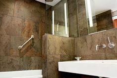 This would work in a small bath.  No rain shower head.