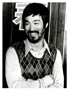 A very candid Bruce Lee. He was usually clean shaven and serious.
