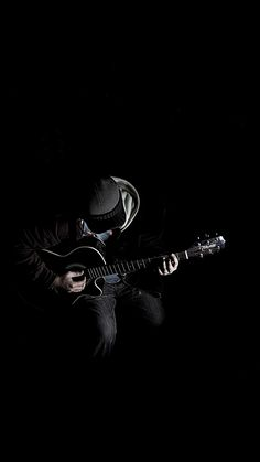 Out The Dark Guitar Player Music iPhone 6 wallpaper Out The Dark Gitarrenspieler Musik iPhone 6 Wallpaper
