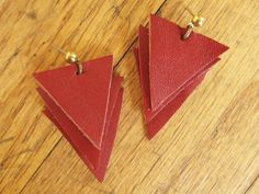 Love the simplicity. I'm going to change this up a bit by making only one, using 2 or 3  coordinating shades of leather and adding ball chain for a necklace -- Original pinner post: Leather Triangle Earrings - Luxe DIY -