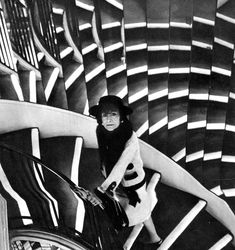 Coco Chanel on her atelier's staircase