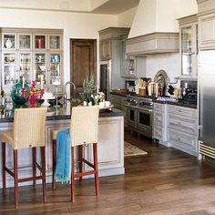 A light colored engineered wood flooring and white washed cabinetry creates a cool, monochromatic look.