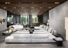 """Lawrence """"Clan"""" seating system and Jacques angled sofa, Rodolfo Dordoni design."""