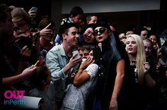 Lady Gaga poses for selfies with fans as she arrives in Perth