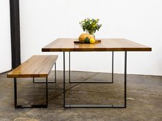 A modern style of dining table featuring welded square steel legs and a solid timber top.  To complement the minimal leg design, the top timbers are chosen with unique grain feature and character.  Timbers are finished with quality natural timber oil and wax.  Pictured with a 40mm thick recycled Australian hardwood top, and 100x10mm legs in black satin powdercoat.  Custom dimensions, timbers and powdercoat colours available on consultation.  Matching bench seats sold separately priced from…