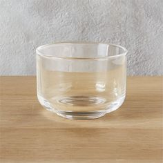 Shop Roundish Mini Glass Bowl.   Mini glass bowl is a sweet spot for candy, nuts, small bites.  Fun as a group with roundish mini bowls mint, royal blue and mauve.  roundish glass mini bowl is a CB2 exclusive.