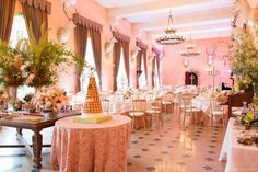 Room setup for the reception at the Salle des Trophées at the wedding in Chateau D'Esclimont, France.